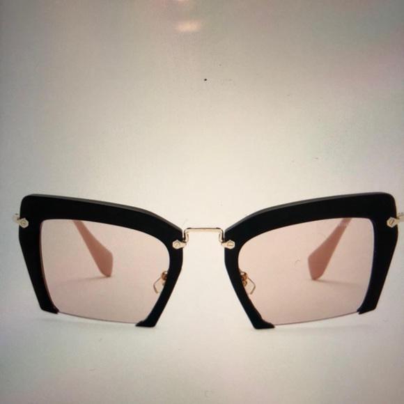 24566f776ad Miu Miu Black Cat Eye Rasoir Sunglasses